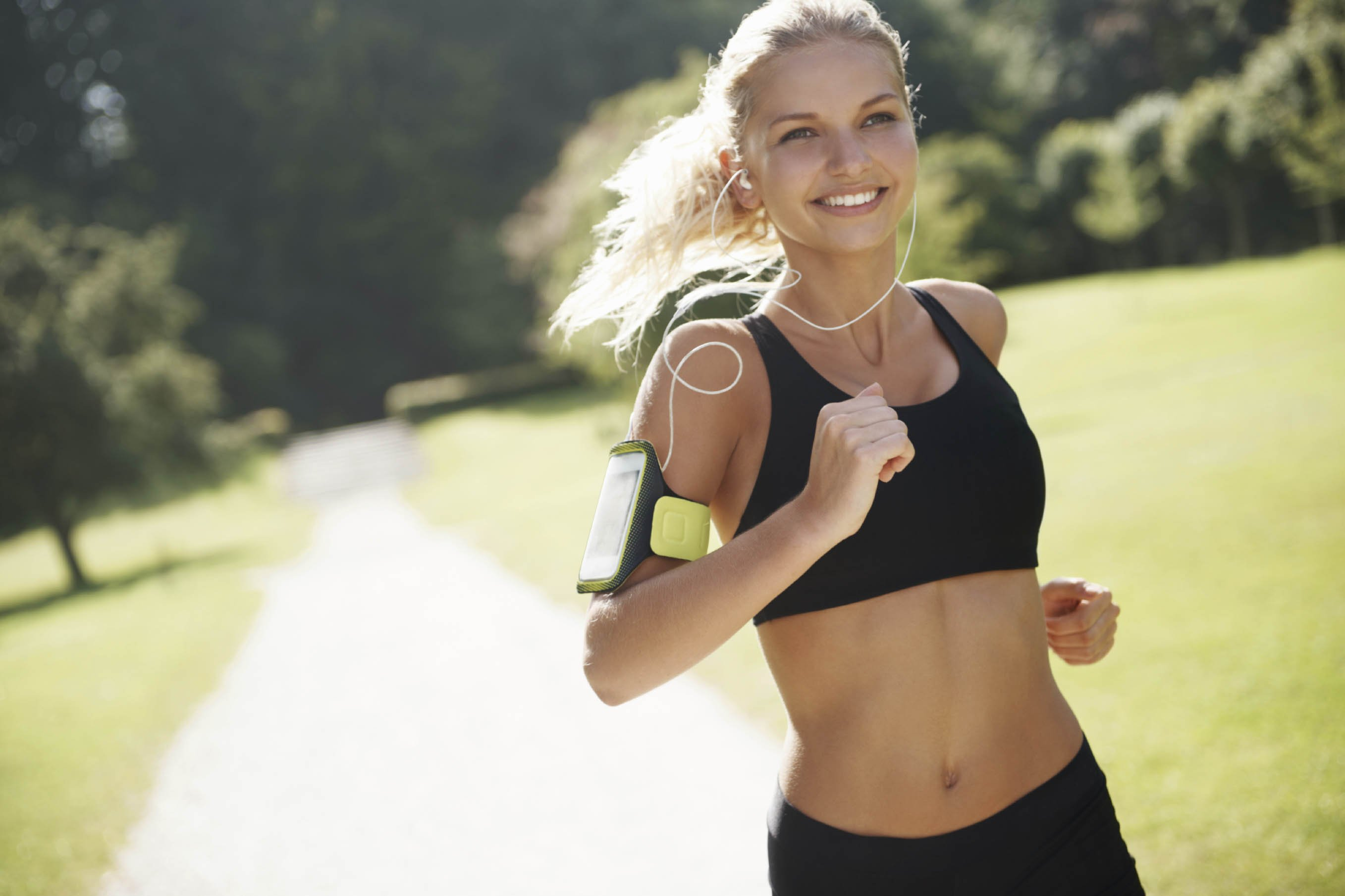 Fit and healthy female jogger running outdoors for her workout